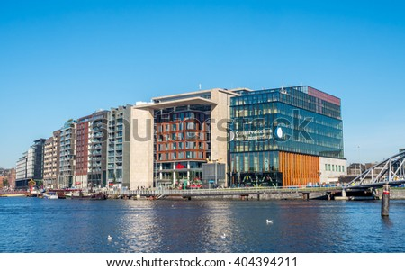 AMSTERDAM - OCTOBER 2: Architecture design buildings around pier near train station in Amsterdam, Netherlands, on October 2, 2015.