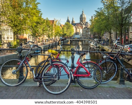 AMSTERDAM - OCTOBER 2: Saint Nicholas church front of  red light district under blue sky with bicycles and warm morning scene in Amsterdam, Netherlands, was taken on October 2, 2015.
