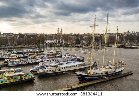 Amsterdam panorama of Oosterdok and Oudeschans with boats in the forefront - stock photo
