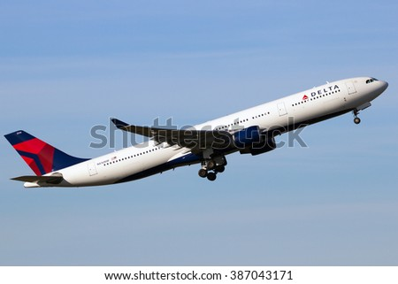 AMSTERDAM-SCHIPHOL - FEB 16, 2016: Delta Air Lines Airbus A330 take-off from Schiphol airport - stock photo