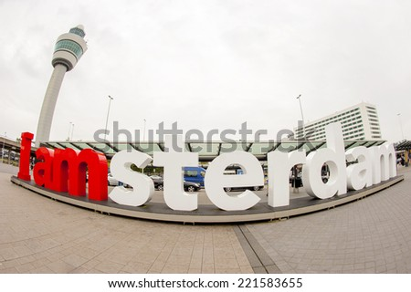 AMSTERDAM SCHIPHOL, THE NETHERLANDS - AUGUST 10, 2014: Wide angle view of the red and white I am Amsterdam sign at the arrival/departure deck at Schiphol airport - stock photo