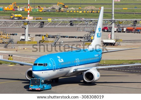 AMSTERDAM - SEP 9, 2012: KLM Boeing 737 at Amsterdam-Schiphol Airport. The airport handles over 45 million passengers per year with almost 100 airlines flying from here.  - stock photo
