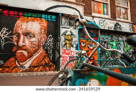 Amsterdam street art - icons. Amsterdam, the Netherlands - April 5, 2013: Parked bicycles in front of a graffiti decorated facade with a self-portrait of Vincent Van Gogh, icon of the city. - stock photo