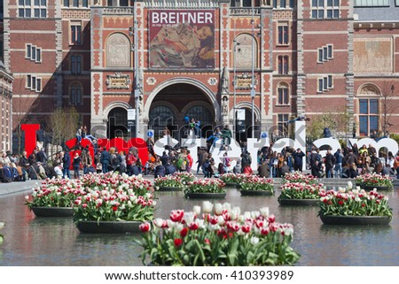 AMSTERDAM, THE NETHERLANDS - APRIL 20, 2016: Beautiful tulips in front of the Rijksmuseum (National state museum), celebrating the tulip festival 2016, on April 20, 2016