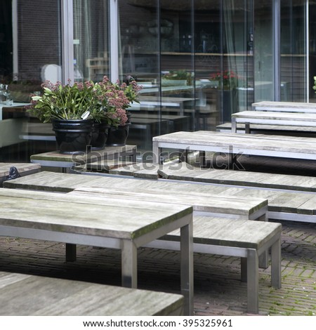 Amsterdam, The Netherlands, April 16, 2012 . Cafe tables in the open air. Wooden table and bench