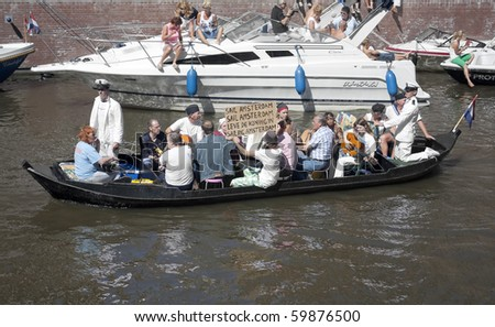 AMSTERDAM, THE NETHERLANDS - AUG 20: Amsterdam natives celebrate Sail-2010 with Pieremachochel, creative boats canal parade, August 20, 2010 in Amsterdam, The Netherlands
