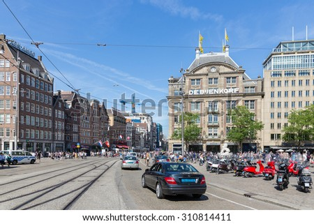 AMSTERDAM, THE NETHERLANDS - AUG 06: People and traffic at De Dam, central plaza of the Dutch capital city on August 06, 2015 in Amsterdam, the Netherlands - stock photo