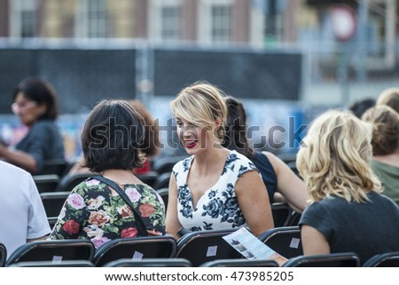 Amsterdam, The Netherlands - August 24 2016: audience at Argentine film Road to la Paz open air screening at Marie Heinekenplein, World Cinema Amsterdam, world film festival held from 18 to 27/08/2016