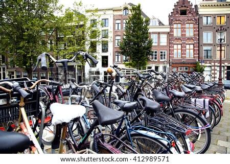 AMSTERDAM; THE NETHERLANDS - AUGUST 16; 2015: Lots of bicycles parked at the bike parking in Amsterdam. Amsterdam is capital of the Netherlands on August 16; 2015. - stock photo