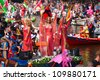 AMSTERDAM, THE NETHERLANDS - AUGUST 4: Participants dance in front of spectators at the famous Canal Parade of the Amsterdam Gay Pride 2012 on August 4, 2012 in Amsterdam - stock photo