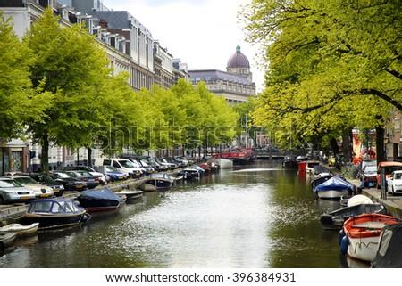 AMSTERDAM; THE NETHERLANDS - AUGUST 18; 2015: View on Leidseplein, beetwen Zieseniskade street and Lijnbaansgracht street from bridge Spiegelgracht in Amsterdam, Netherlands on August 18; 2015. - stock photo