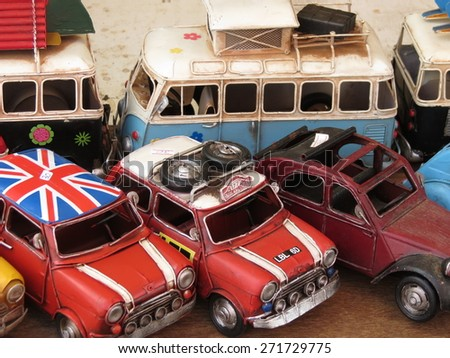 AMSTERDAM, THE NETHERLANDS - CIRCA MARCH 2013: Miniature representation of Volkswagen Van, Mini Cooper and Citroen Diane models from the 60s, produced as children toys - stock photo