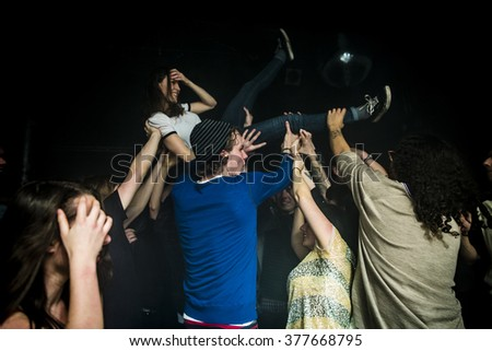 Amsterdam, The Netherlands - 11 february 2016: audience of fans slamdancing during the concert of  Dutch indie rock trio Bombay for their Album Release Show at venue OT301 - stock photo