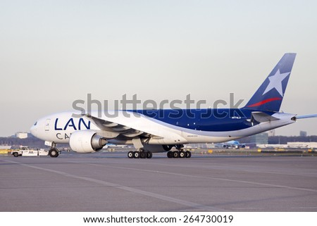 AMSTERDAM, THE NETHERLANDS - FEBRUARY 18, 2015 :.Just arrivedBoeing 777 cargo plane from lan cargo on schiphol airport. On february 18 , 2015 in Amsterdam, Holland.  - stock photo