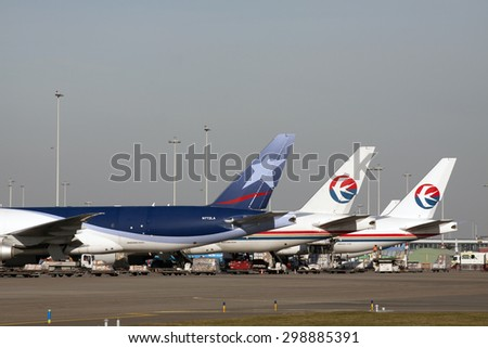 AMSTERDAM, THE NETHERLANDS - FEBRUARY 18, 2015:  Parked Boeing 777 cargo aircraft ready for a commercial cargo flight to their destination on february 18 , 2015 in Amsterdam (Schiphol ), Holland.  - stock photo