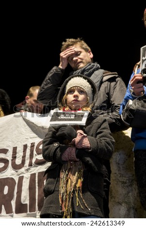 """Amsterdam, The Netherlands, January 08 2015: demonstation in solidarity with the attack against Charlie Hebdo in Paris, France on 07 January, little girl holding a sign saying """"I am Charlie"""" - stock photo"""