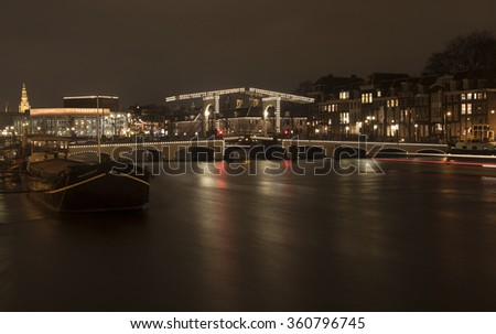AMSTERDAM , THE NETHERLANDS JANUARY 10 2016:image of the skinny bridge (Magere brug )in Amsterdam, the Netherlands, early in the morning in winter on january 10,106 in Amsterdam - stock photo