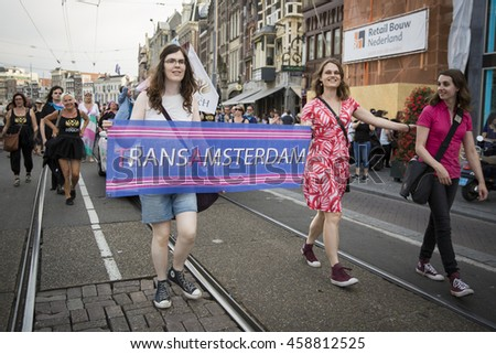 Amsterdam, the Netherlands - July 23, 2016: Transexual association marching at Pride Walk, demonstration parade from Vondelpark to Dam Square during Pink Saturday Gay Euro Pride celebrations