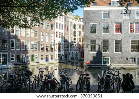 Amsterdam The Netherlands - June 15: Bicycles parked on the edge of a canal  on June 15, 2015. - stock photo