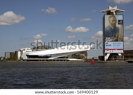 AMSTERDAM,THE NETHERLANDS - JUNE 2 ; Eye film museum also a tower with an image of the painter Vincent van Gogh on June 2 ,2013 in Amsterdam, The netherlands - stock photo