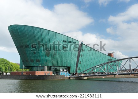 AMSTERDAM, THE NETHERLANDS - June 15, 2014: The Nemo (Science) Museum, designed in the form of a ship by architect Renzo Piano and seen from the water in Amsterdam, The Netherlands, on June 15, 2014. - stock photo