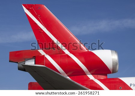 AMSTERDAM, THE NETHERLANDS - Maart 11, 2015 :Contrasting picture of the rear of a  plane from  martinair cargo and In the background a cloudless blue skyOn maart 11 , 2015 in Amsterdam, Holland.   - stock photo