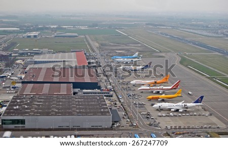 AMSTERDAM, THE NETHERLANDS, 26 MARCH 2015 - Airplanes loading on Amsterdam Airport Schiphol, The Netherlands. - stock photo