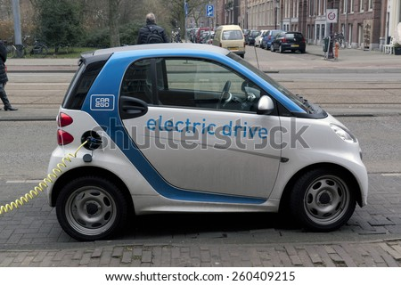 Amsterdam,The Netherlands-march 14,2015: Electric car at a charging station in Amsterdam. Charging it's battery - stock photo