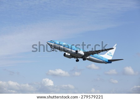 AMSTERDAM, THE NETHERLANDS - MAY, 13. A Boeing 737-8BK of KLM just takes off at Amsterdam Airport Schiphol (The Netherlands, AMS) on May 13, 2015. The aircraft is already high in the air.