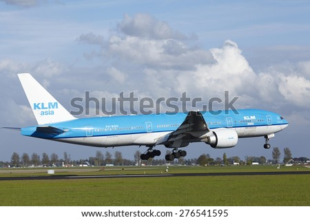 AMSTERDAM, THE NETHERLANDS - MAY, 7. A Boeing 777-206(ER) of KLM lands at Amsterdam Airport Schiphol (The Netherlands, AMS) on May 7, 2015. The name of the runway is Polderbaan.