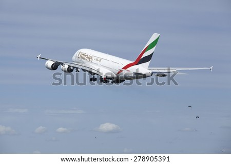 AMSTERDAM, THE NETHERLANDS - MAY, 13. An Airbus A380-861 of Emirates takes off at Amsterdam Airport Schiphol (The Netherlands, AMS) on May 13, 2015. The name of the runway is Polderbaan. - stock photo