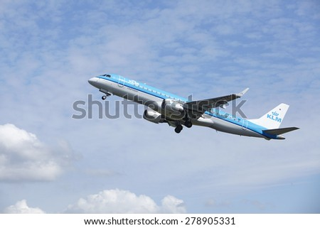 AMSTERDAM, THE NETHERLANDS - MAY, 13. An Embraer ERJ-190 of KLM Ciythopper just takes off at Amsterdam Airport Schiphol (The Netherlands, AMS) on May 13, 2015. The aircraft is already high in the air.