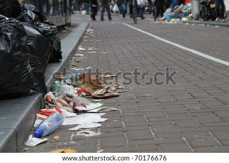 AMSTERDAM, THE NETHERLANDS - MAY 15: Garbage piled up during the week long workers strike that ended today. May 15, 2010, in Amsterdam, The Natherlands - stock photo