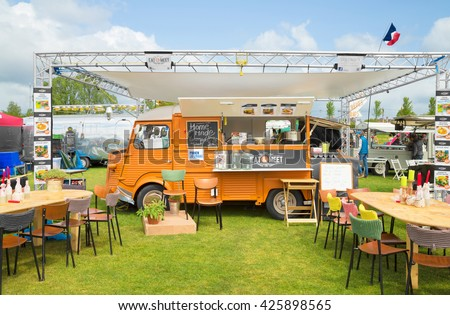 AMSTERDAM, THE NETHERLANDS - MAY 14, 2016: Mobile kitchen Eat and Meet sells international vegetarian cuisine during the annual mobile kitchens weekend, held in the city's Culture park