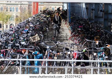 AMSTERDAM, THE NETHERLANDS - NOVEMBER 09: Few storey bicycle parking in Amsterdam, The netherlands on November 09, 2014. - stock photo