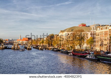 AMSTERDAM, THE NETHERLANDS - NOVEMBER 10: Houses by a canal in Amsterdam, The Netherlands, Europe on November 10, 2014.