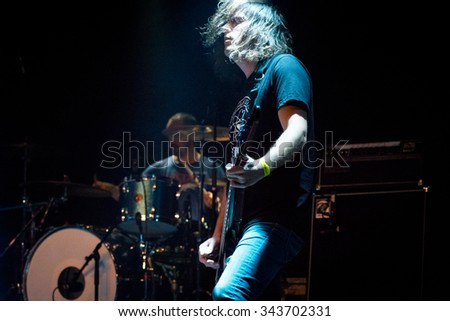 Amsterdam, the Netherlands - November 16, 2015: Mark Hamilton of Irish rock band Ash performs live on stage at the Melkweg music hall.