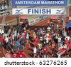 AMSTERDAM, THE NETHERLANDS - OCT 17: International participants cross the finish line in the shorter, 8 km version, of the Amsterdam Marathon, October 17, 2010 in Amsterdam, The Netherlands - stock photo