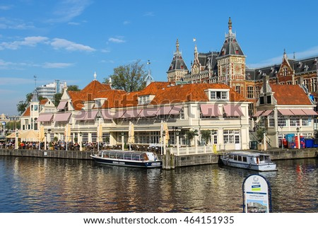 Amsterdam, the Netherlands -October 03, 2015: Tourist boats on the canal of Amsterdam in historic city centre