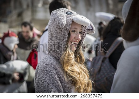 Amsterdam, The Netherlands - Saturday, April 4 2015: Young girl with a sheep costume participating in the Pillow Fight on Dam Square. This event is part of the worldwide international pillow fight day - stock photo