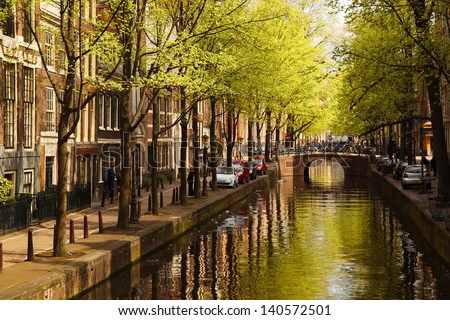 Amsterdam with  green canal in the downtown, Holland - stock photo