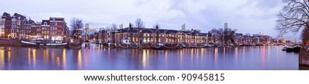 Amsterdam with the Thiny Bridge at christmas time in the Netherlands at sunset