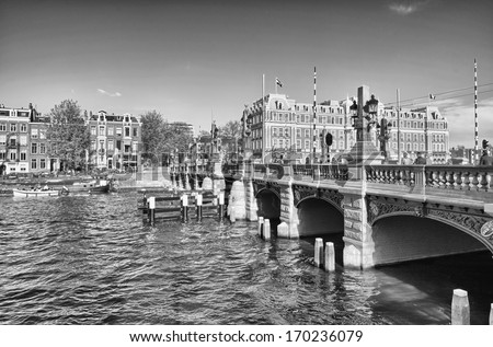 Amsterdam. Wonderful view of city canals and buildings in spring season.