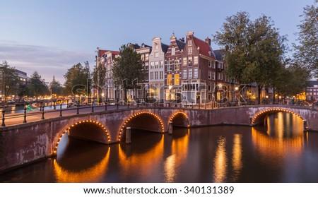 Amsterdams cityscape at dusk twilight - stock photo