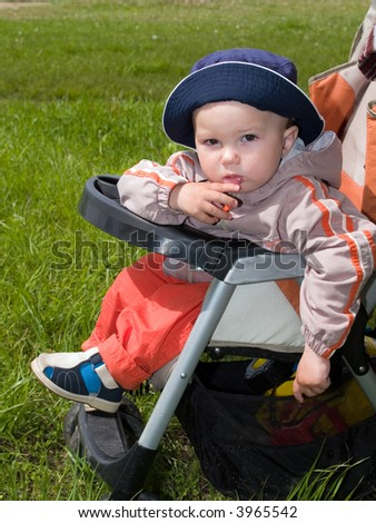 amused boy sitting in stroller