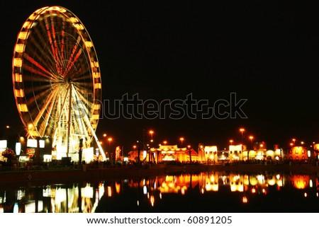 Amusement park at night. conceptual image of entertainment & fun - stock photo