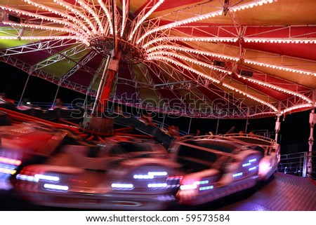amusement park by night - stock photo