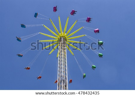 Amusement park chairoplane in the sky