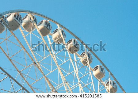 amusement park, ferris wheel in a clear day - stock photo