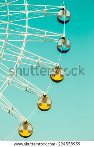 Amusement park ferris wheel in the blue sky - stock photo